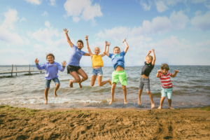 Kids Jumping at Lake