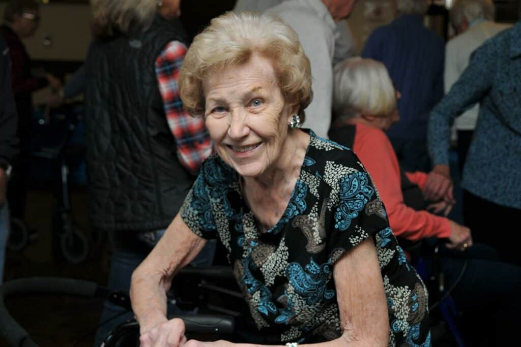 Betty Jean senior woman sitting in chair smiling