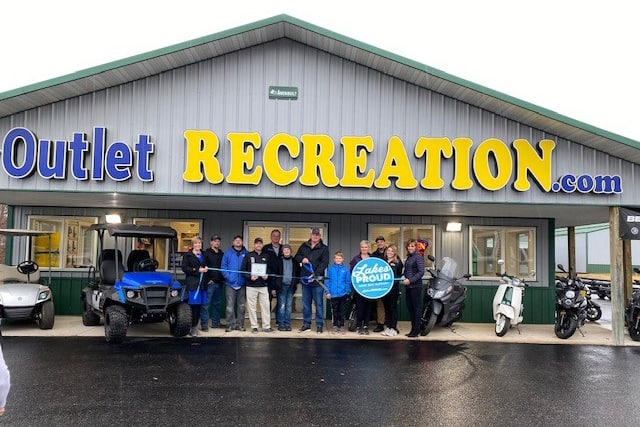 Outlet Recreation New Member Photo Ribbon Cutting