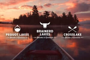 Canoe in Lake at sunset with white Chamber logo on top