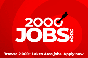 2000 Jobs logo white with red arrow going into bullseye on red background