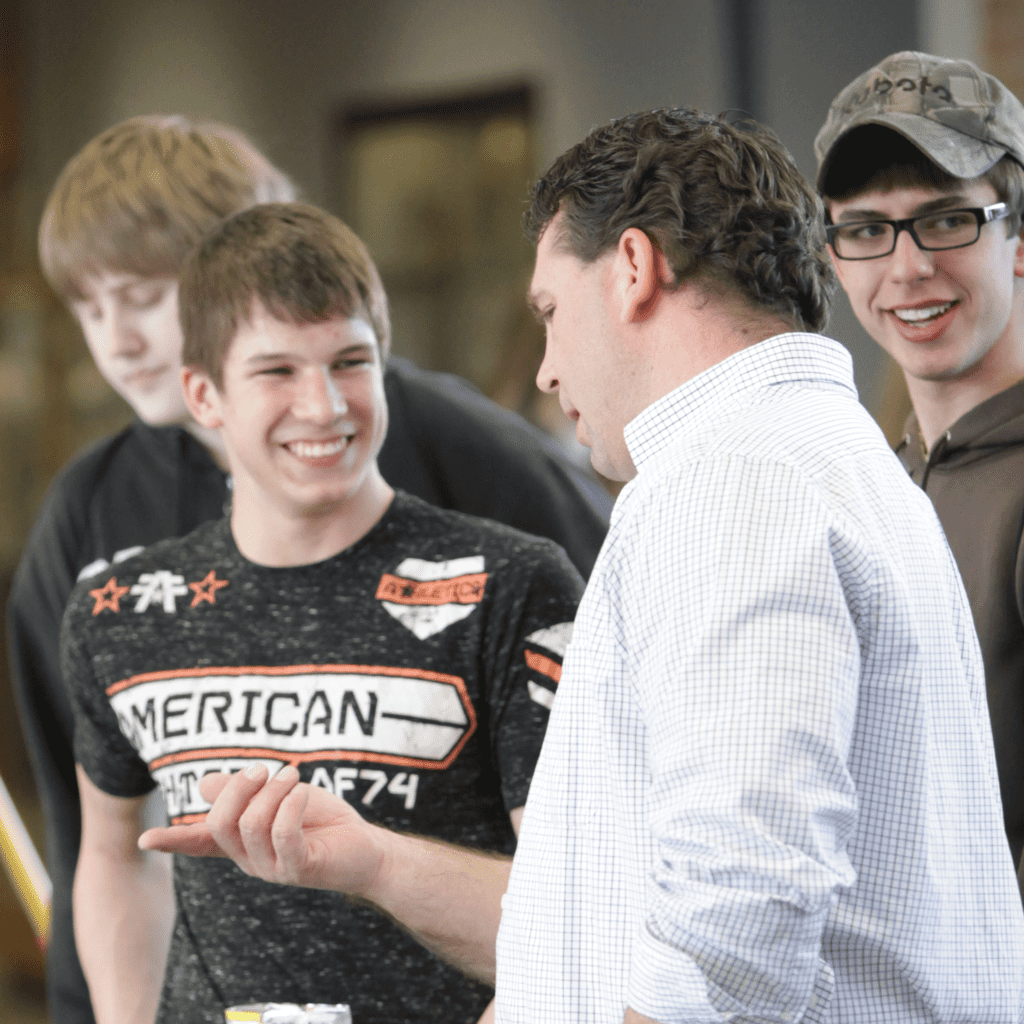 Young Man at Career Fair talking to Potential Employer Square Photo