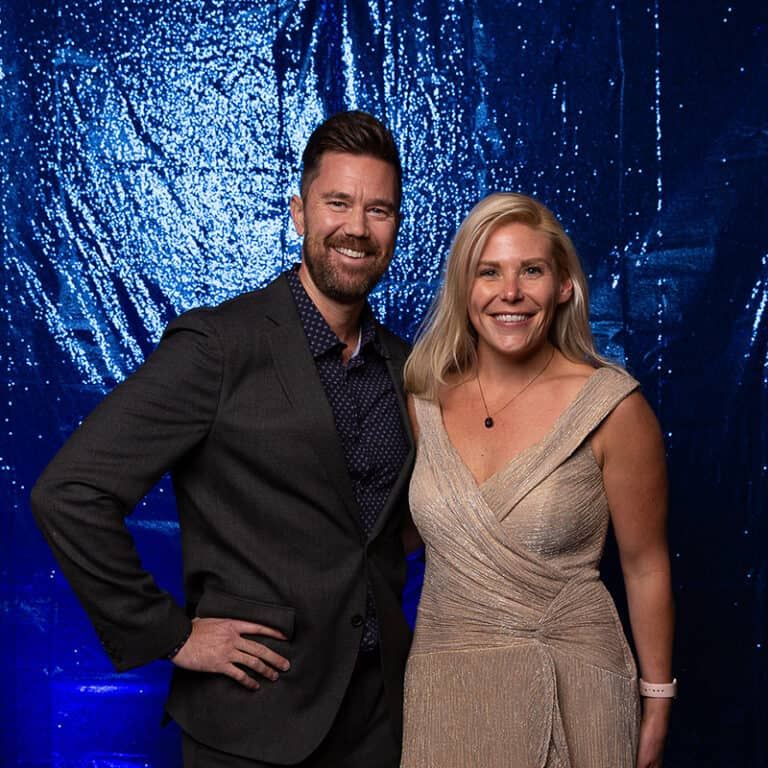 2021 Celebration Of Excellence Couple Portrait in front of Blue Glitter Backdrop #1