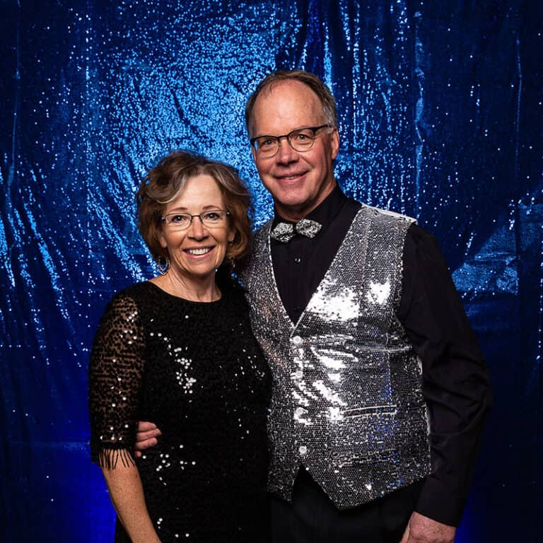 2021 Celebration Of Excellence Couple Portrait in front of Blue Glitter Backdrop #2