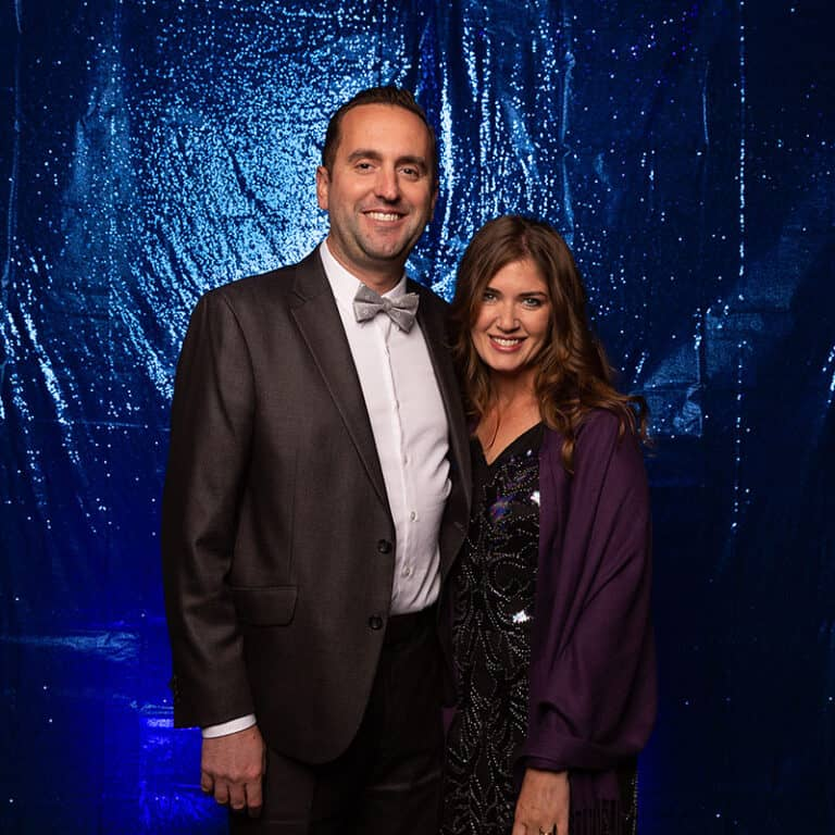 2021 Celebration Of Excellence Couple Portrait in front of Blue Glitter Backdrop #3