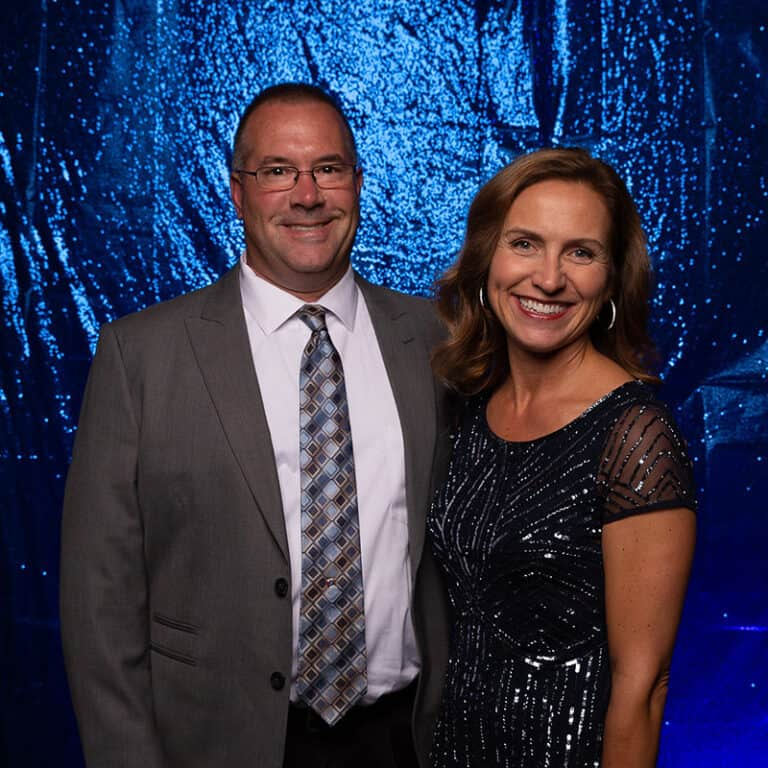 2021 Celebration Of Excellence Couple Portrait in front of Blue Glitter Backdrop #4