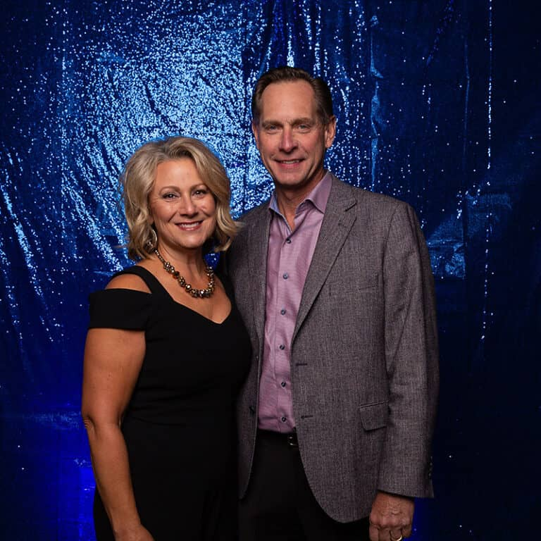 2021 Celebration Of Excellence Couple Portrait in front of Blue Glitter Backdrop #5