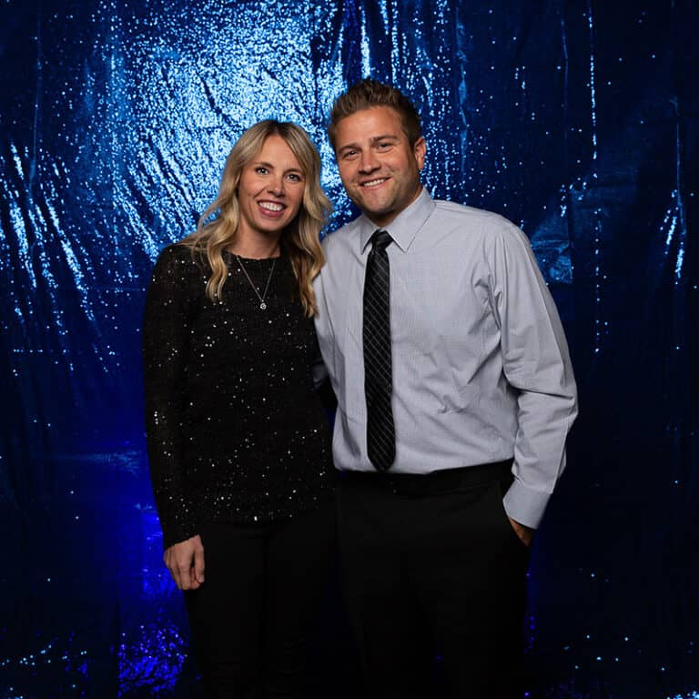 2021 Celebration Of Excellence Couple Portrait in front of Blue Glitter Backdrop #6
